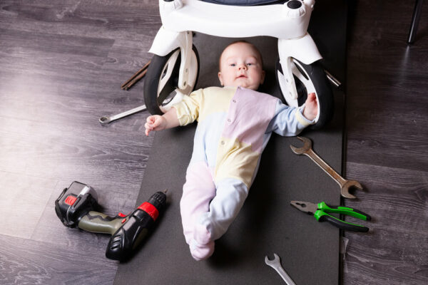 Baby boy repairing an electric toy car